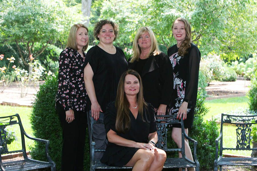 About - Renee Jackson Insurance Agency Team Standing With Renee Sitting In The Front