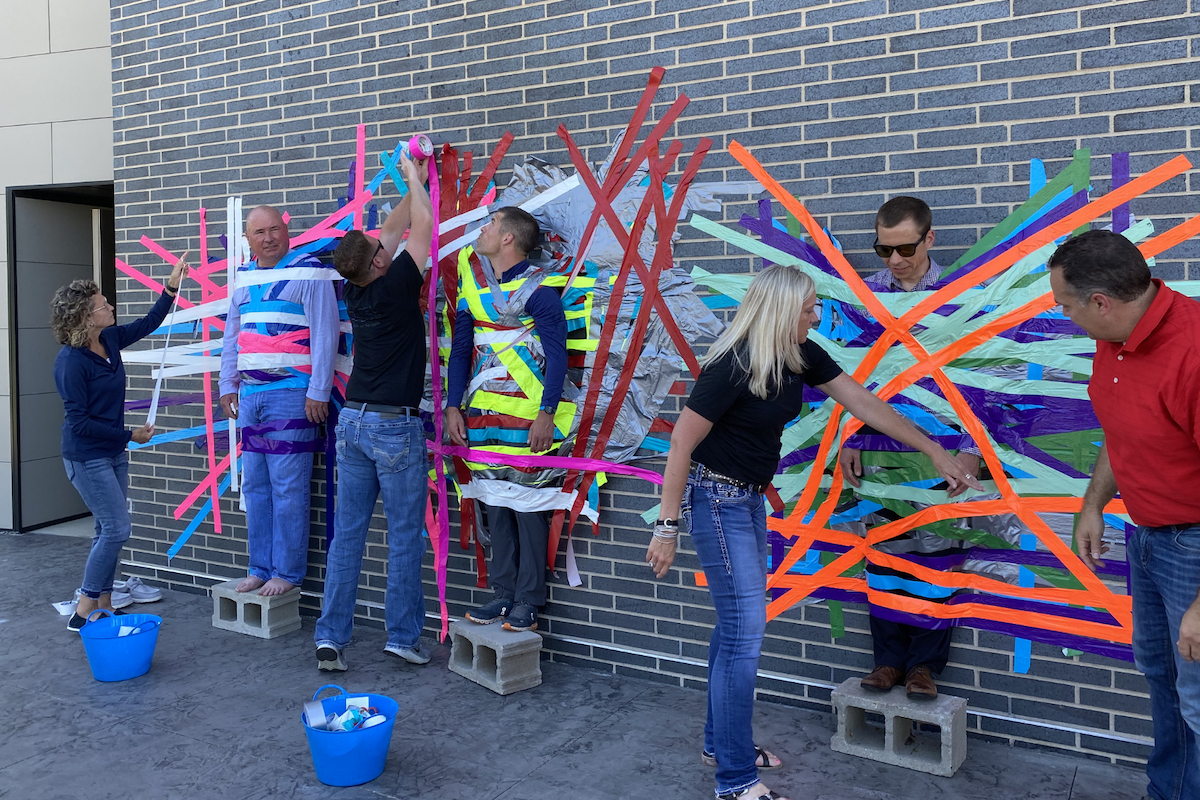 Culture and Careers - Team Members Duct Taped To Wall