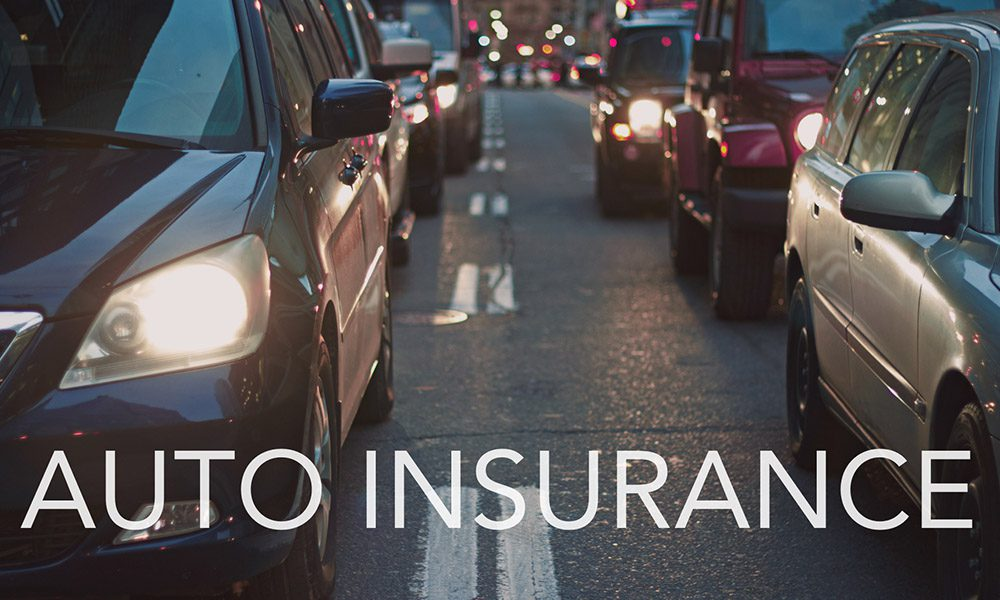 Auto Insurance 101 Part 1 Liability Protection - Traffic in the Evening with Auto Insurance Text