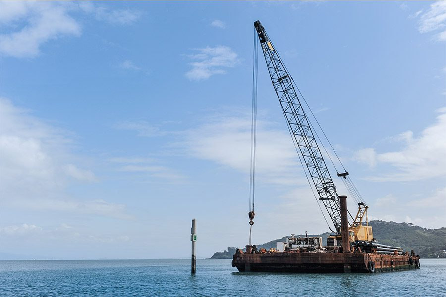 Marine Insurance - Floating barge with a large crane