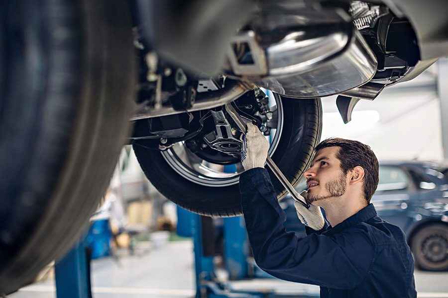 Specialized Business Insurance - Auto Mechanic Working on Car in Auto Garage Shop