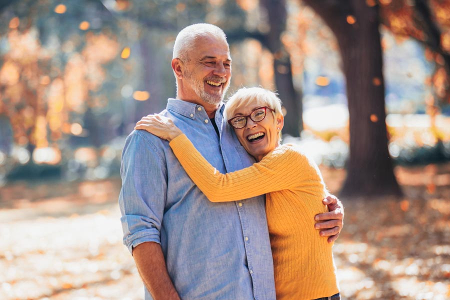 Client Center - Modern Older Couple Hanging out in the Park During Fall