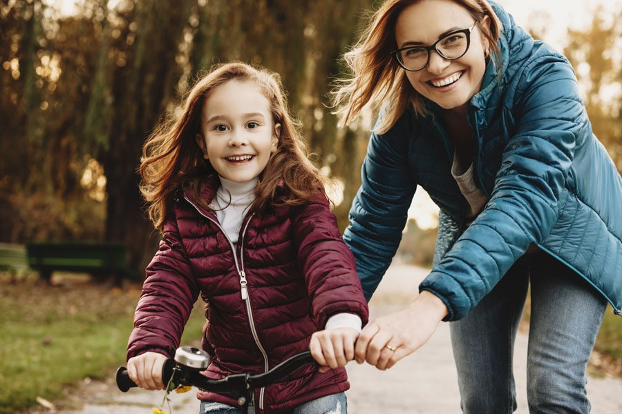 Personal Insurance - Mother and Daughter Learning How to Ride a Bike