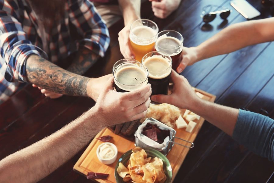 Specialized Business Insurance - Group of Friends Having Drinks at a Bar with Beer Pints