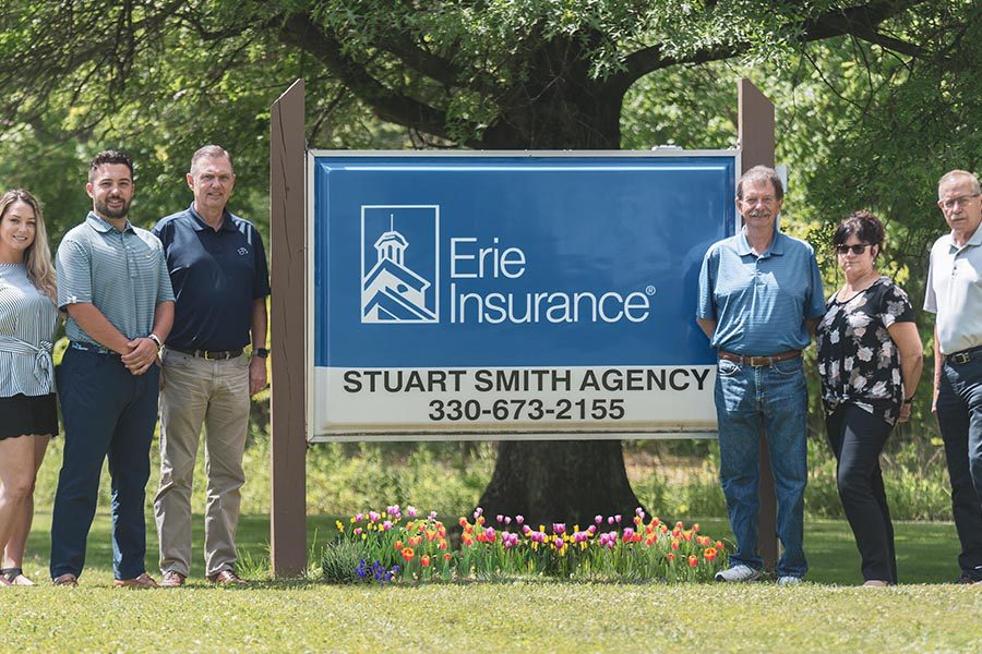 About Our Agency - Stuart Smith Agency in Front of Erie Insurance Sign