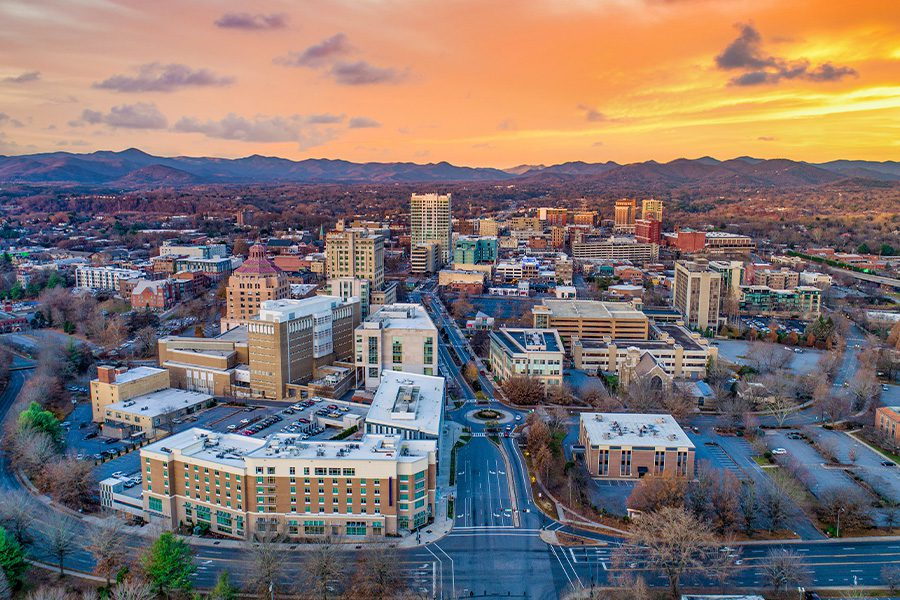 Burlington, NC - Aerial Drone View of City Skyline in North Carolina at Sunset