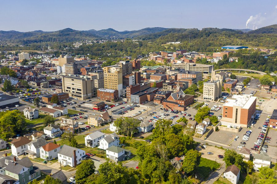 Beckley, WV - Aerial Perspective with Bright Sun in the Late Afternoon of a Town in West Virginia