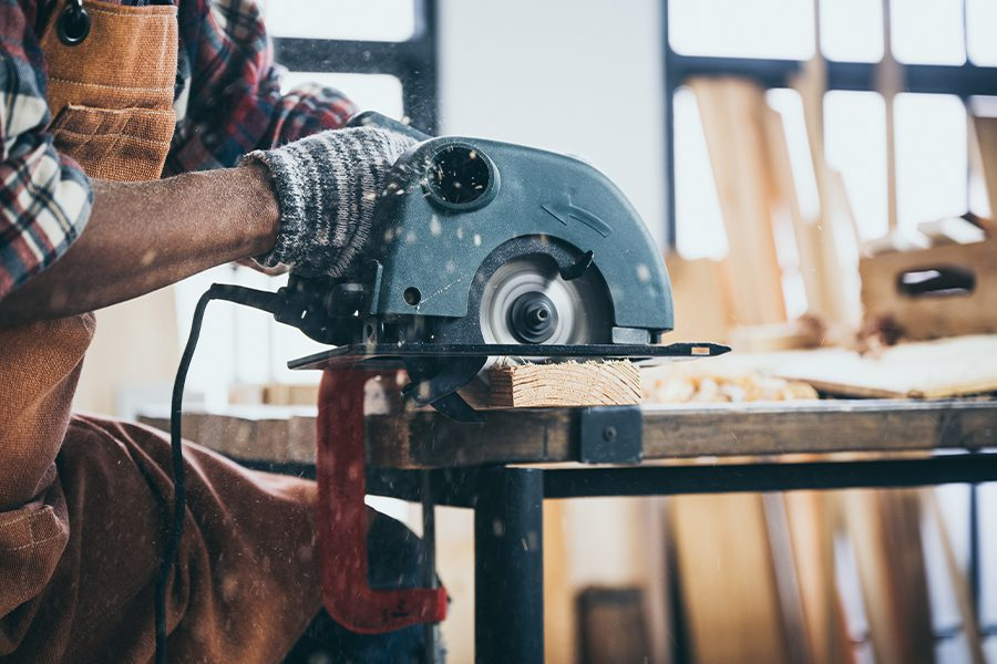 Specialized Business Insurance - A Close-up View of a Carpenter Using an Electric Circular Saw to Cut Wood