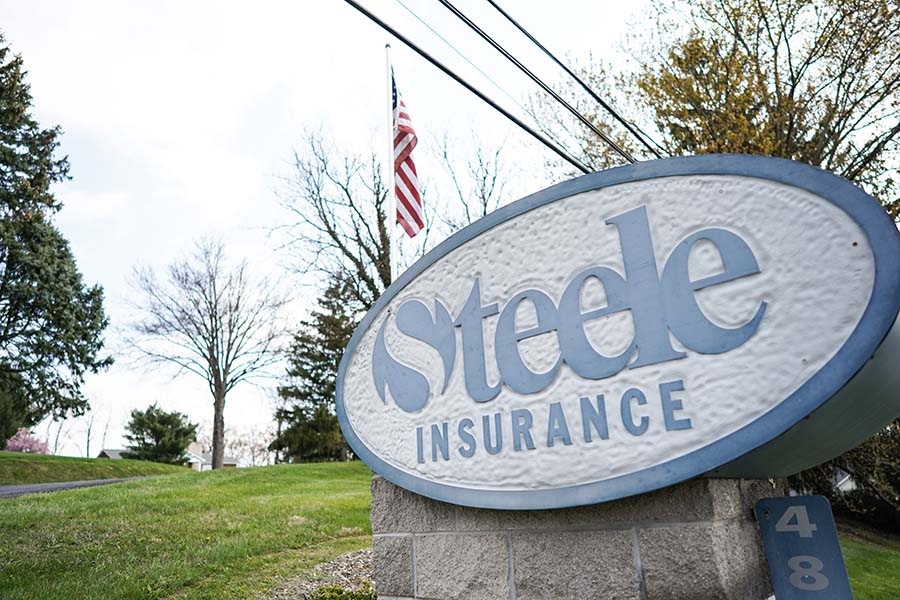 About Our Agency - View of Steele Insurance Logo Outside Office Building