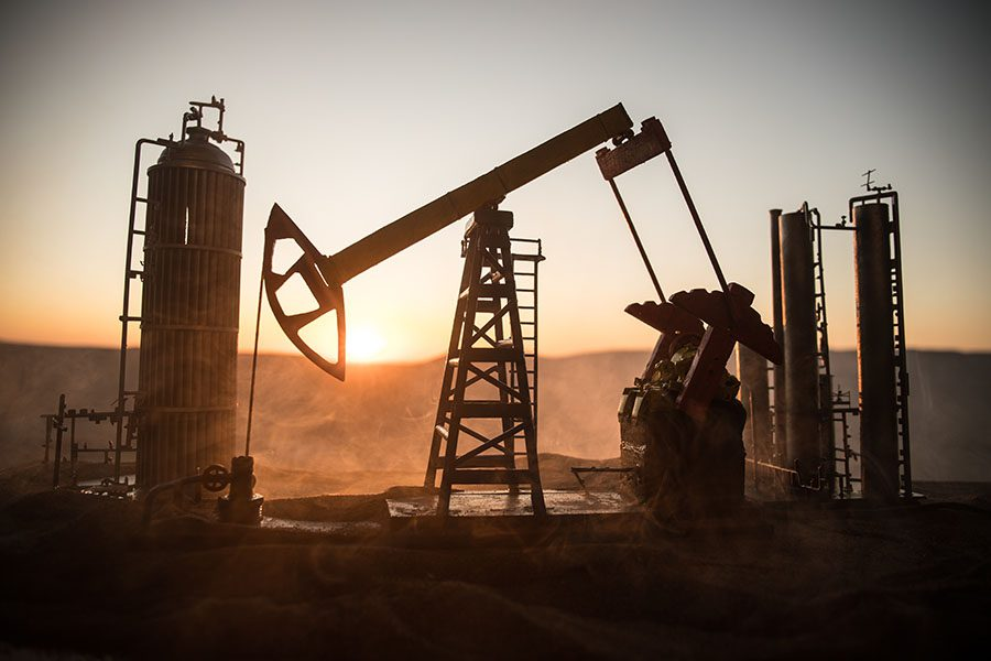 Energy Oil And Gas And Mining Insurance - View of Oil Refinery Equipment in the Desert