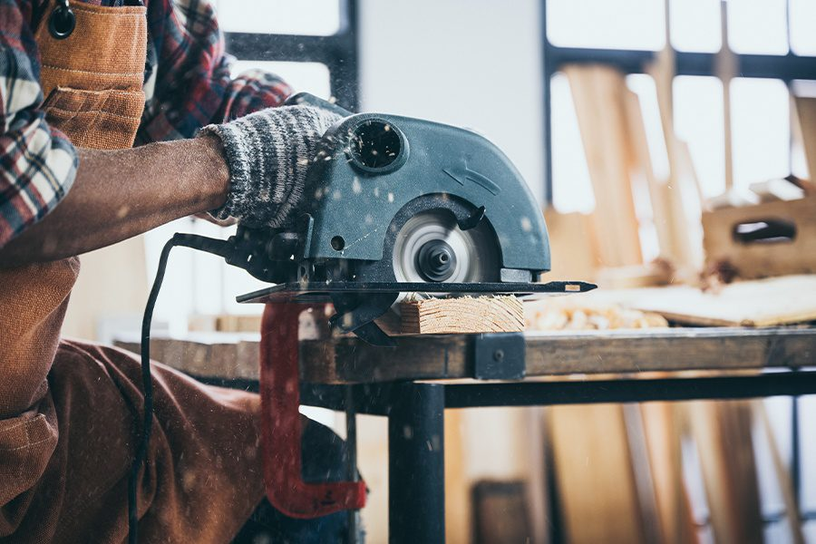 Specialized Business Insurance - The Carpenter is Using an Electric Circular Saw to Cut Wood