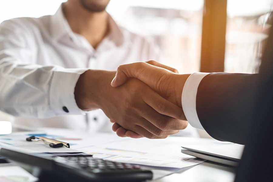 Finish Your Online Quote - Business Insurer and Client Shaking Hands After Accepting Insurance Coverage From Quote