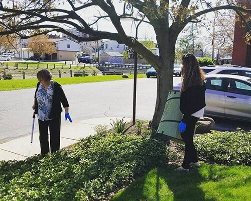 Community - Strickler Insurance Team Member Cleaning Up Near Curb