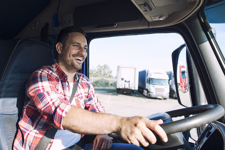 Specialized Business Insurance - Portrait Of Happy Truck Driver Driving His Truck