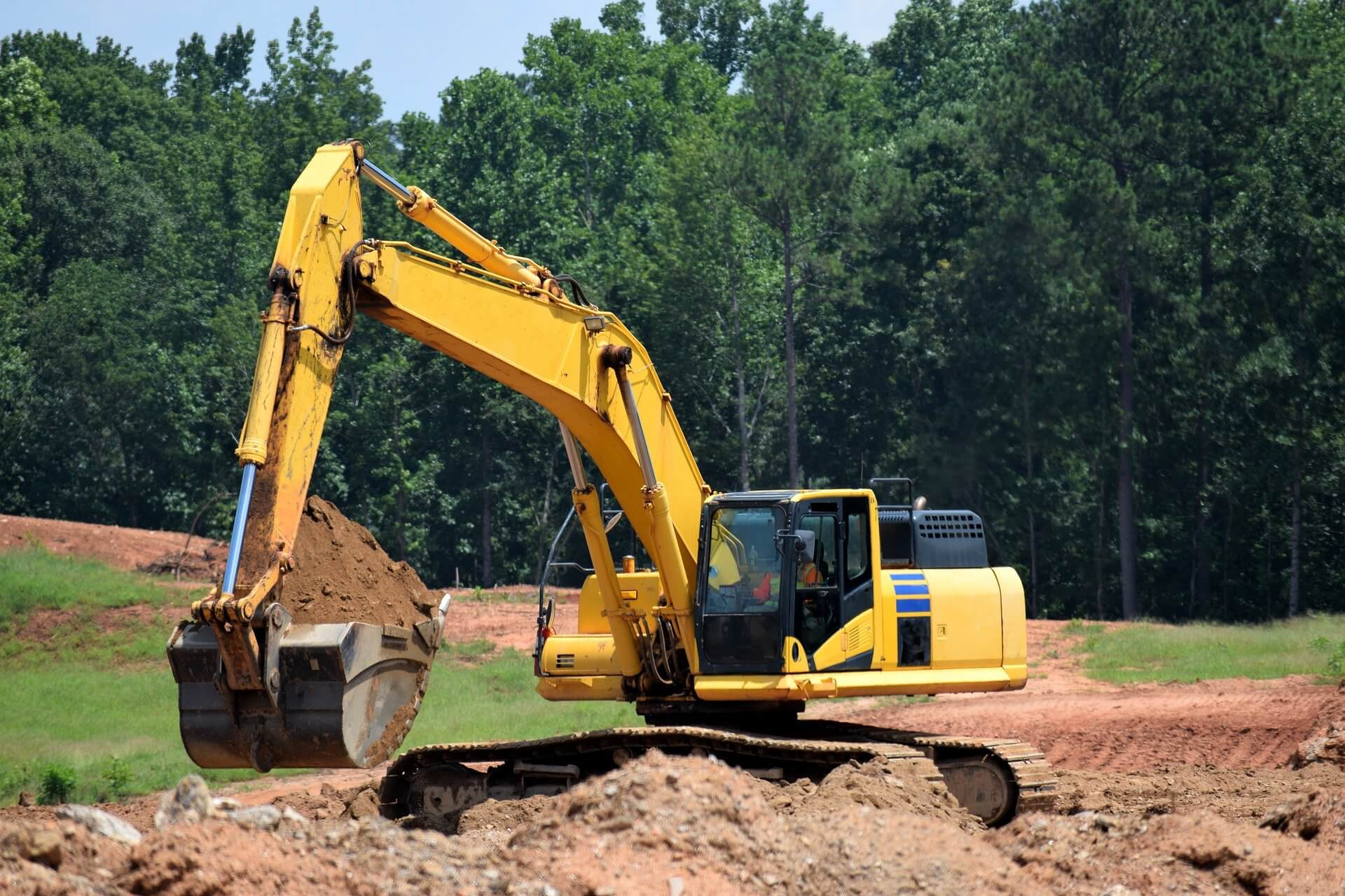 Stock photo of a construction site with a cat excavator.