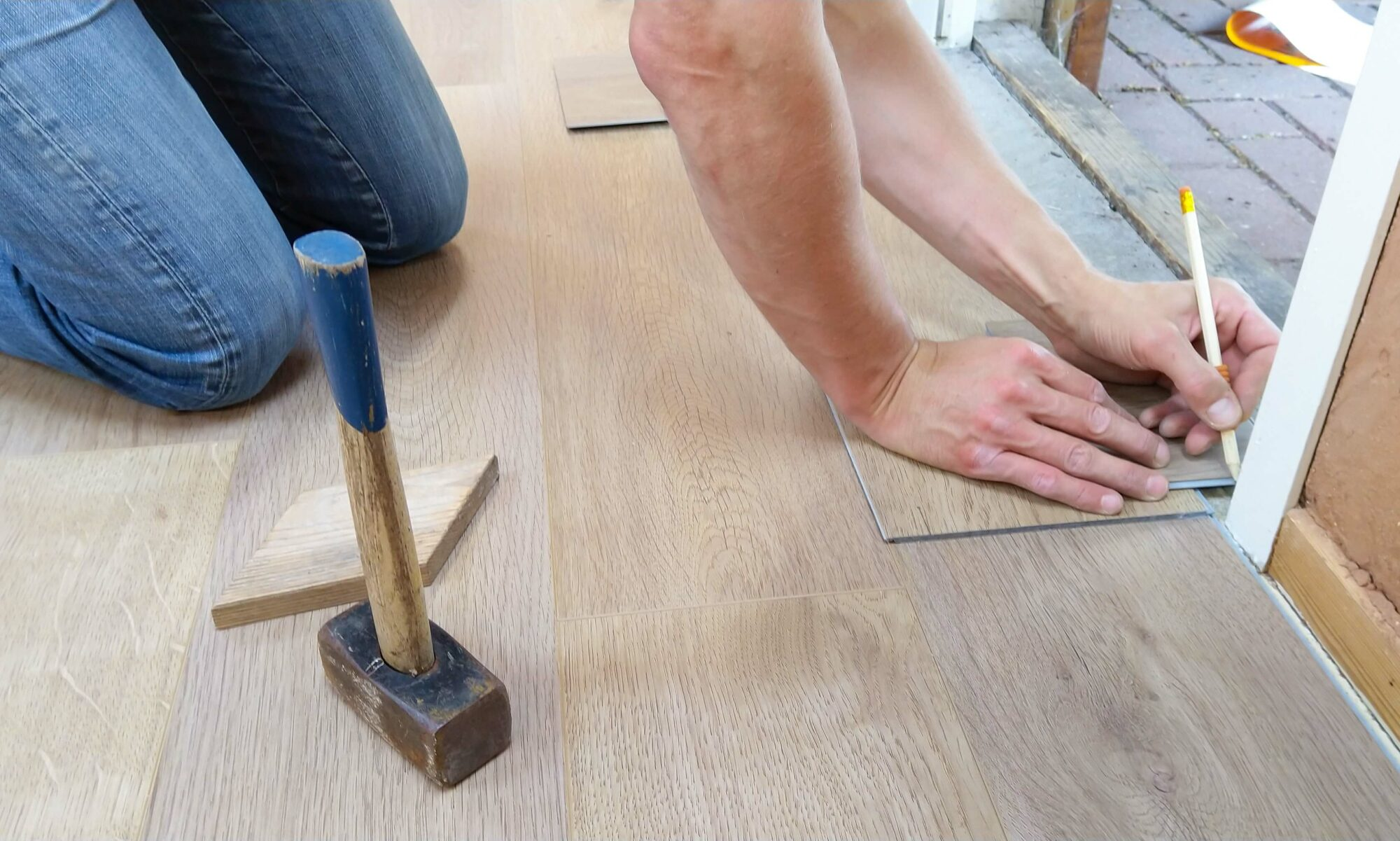 Stock image of man replacing flooring.