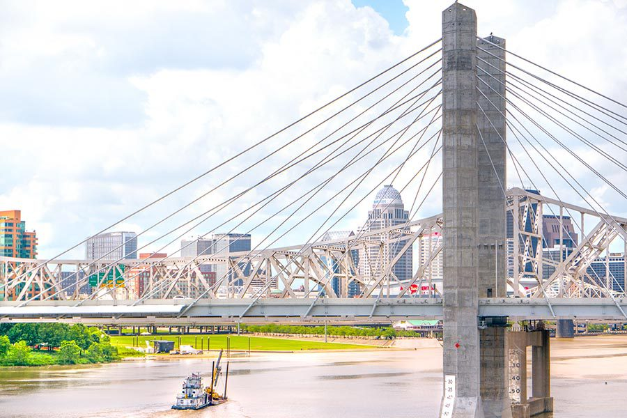 Indiana and Kentucky Insurance - Bridge Over River With Louisville Skyline