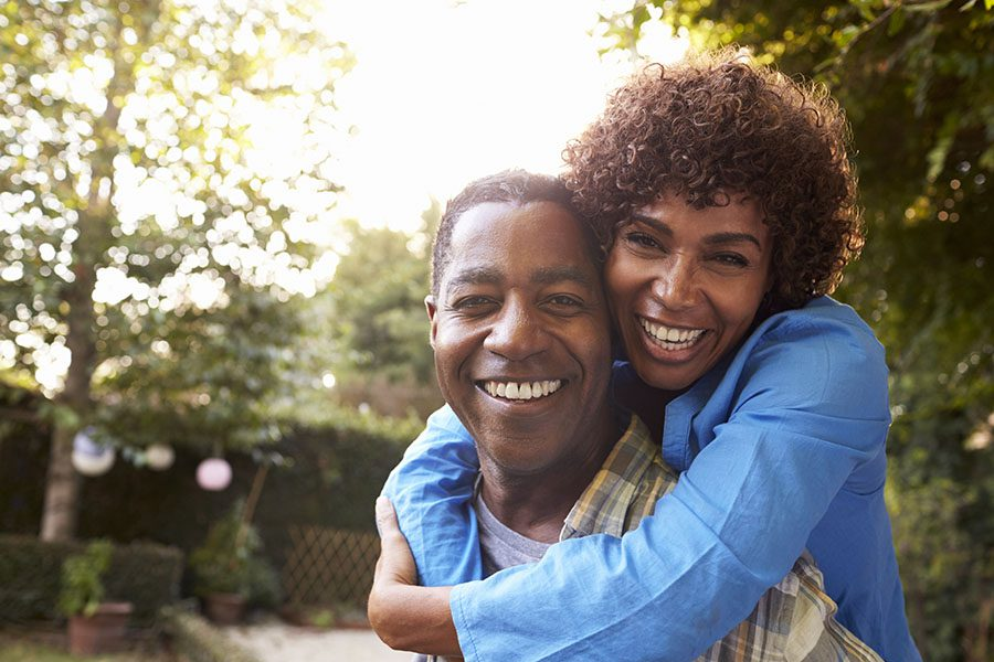 Life and Health Insurance - View of Happy Mature Couple Standing in the Backyard