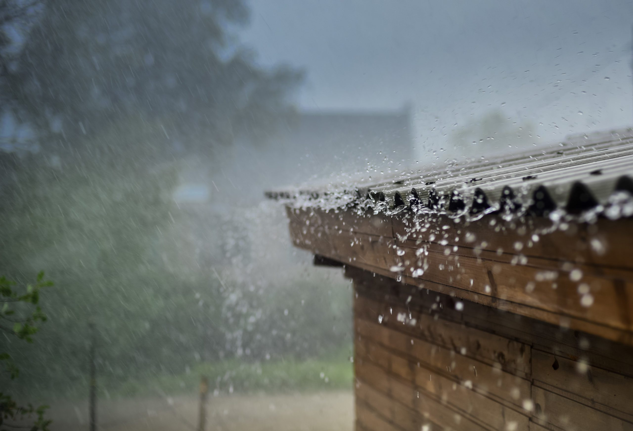 Blog - rain flows down from a roof down