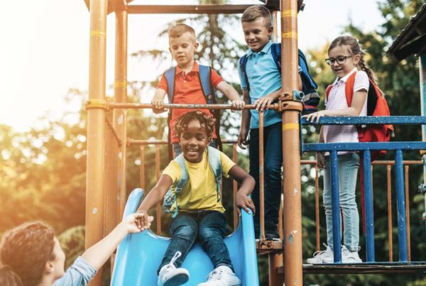 Keep Your Child Safe on Outdoor Play Equipment - Group of Children Playing at a Playground at Sunset