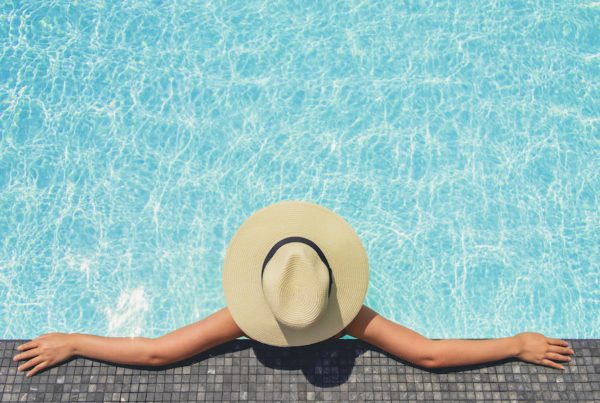Carefree woman relaxation in swimming pool summer Holiday concept
