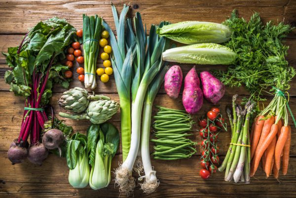 table filled with fresh vegetable produce