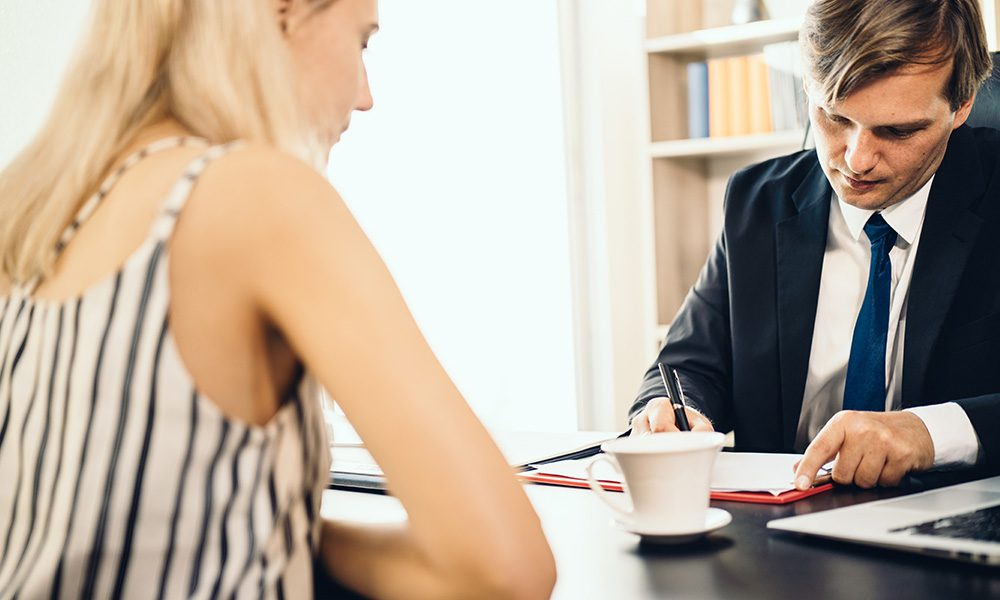 Blog - Professional Discussing Fraud Portection in the Office with a Client
