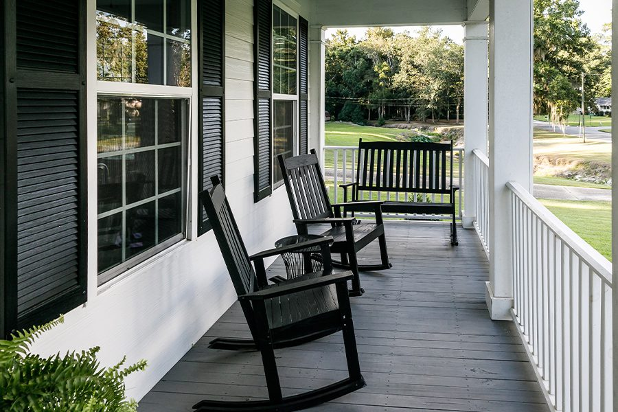 Berwick, PA - Front Porch of Country Home with Black Rocking Chairs and Casual Feel