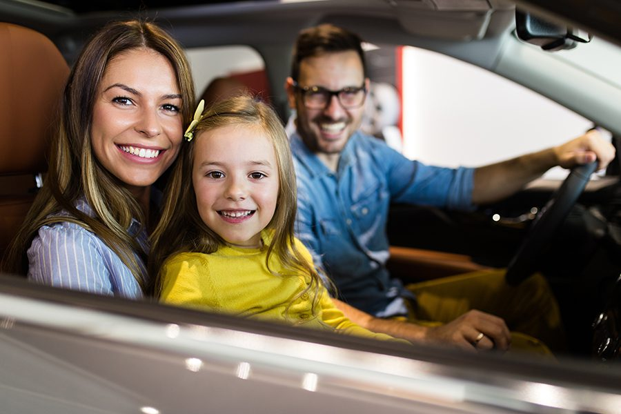 Personal Insurance - Happy Family Getting Ready to Buy a New Car in Showroom