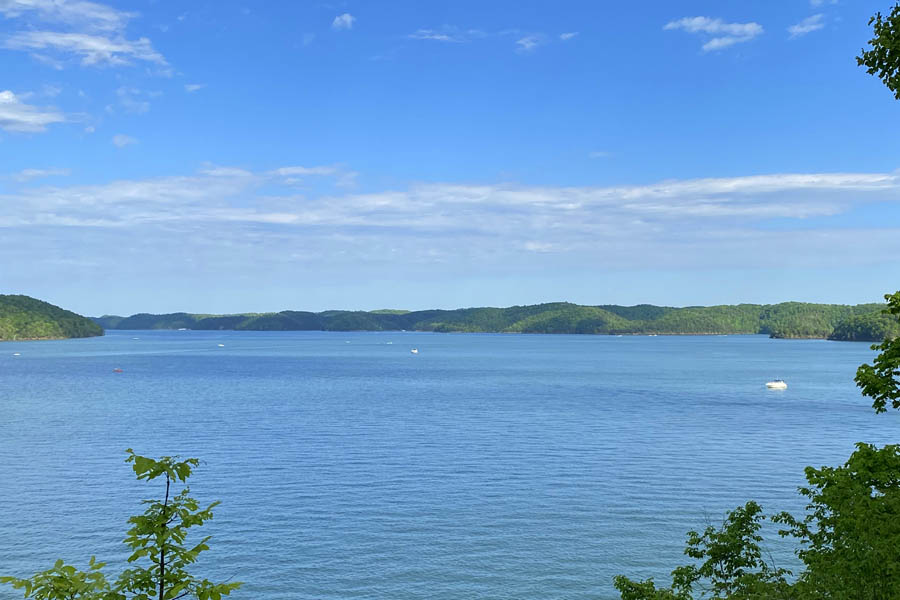 About Our Agency - View of a Lake with Boats Riding Around on a Summer Day