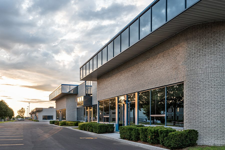 Business Insurance - The Exterior Facade of a Mid Sized to Small Business Building at Dusk