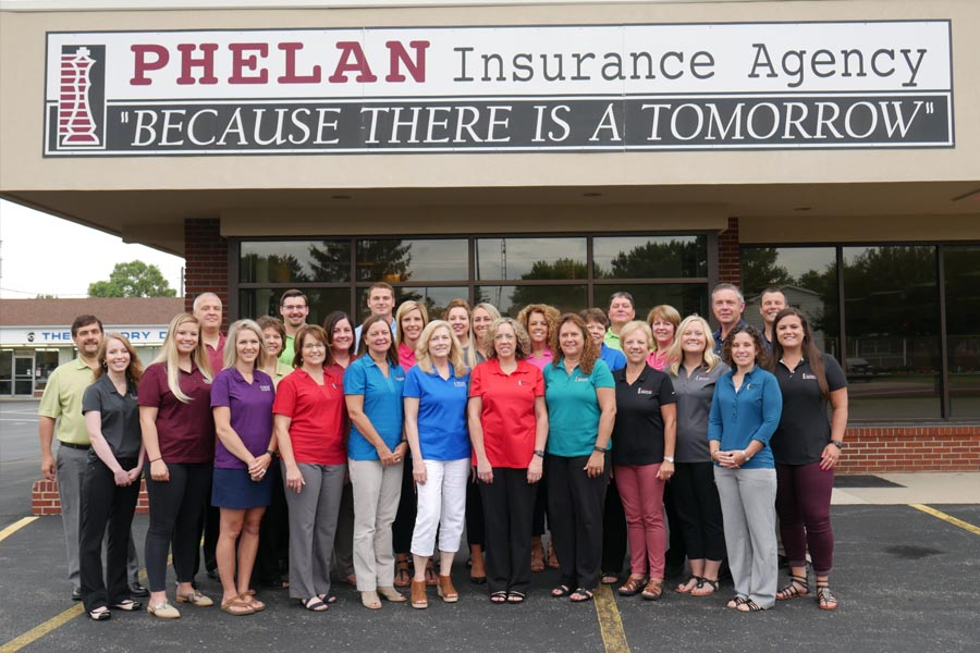 About Our Agency - Phelan Insurance Agency Team Members Standing Outside the Office