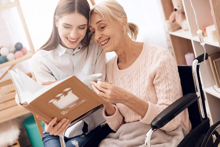 Long-Term-Care-Insurance-Grandmother-and-Child-Looking-at-Photo-Albums