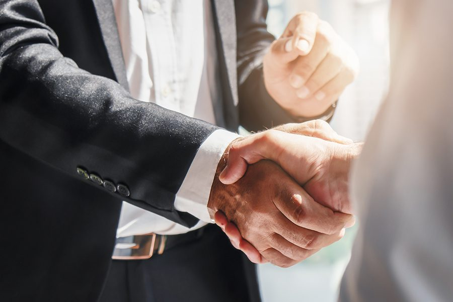 About Our Agency - Businessmen at Fail Safe Advisers Shaking Hands Over Successful Meeting