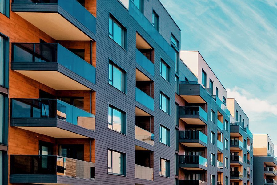 Specialized Business Insurance - Angled View of Rows of Modern Condo Complex of Residential Buildings in the Summertime