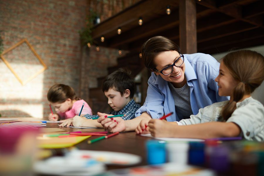 Child Care Center Insurance - Children with Teacher at the Child Care Center