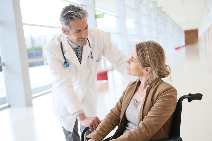 Long-Term Disability - Patient with Doctor After Surgery