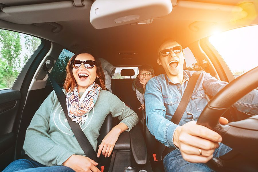 Insurance Quote - Cheerful Family Driving Car And Singing Aloud