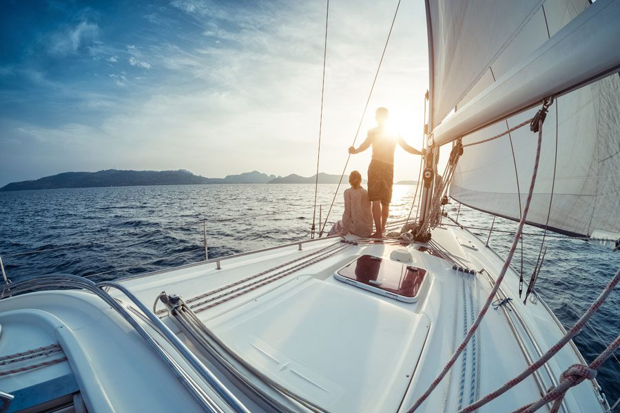 Watercraft Insurance, family sailing on a yacht in open seas