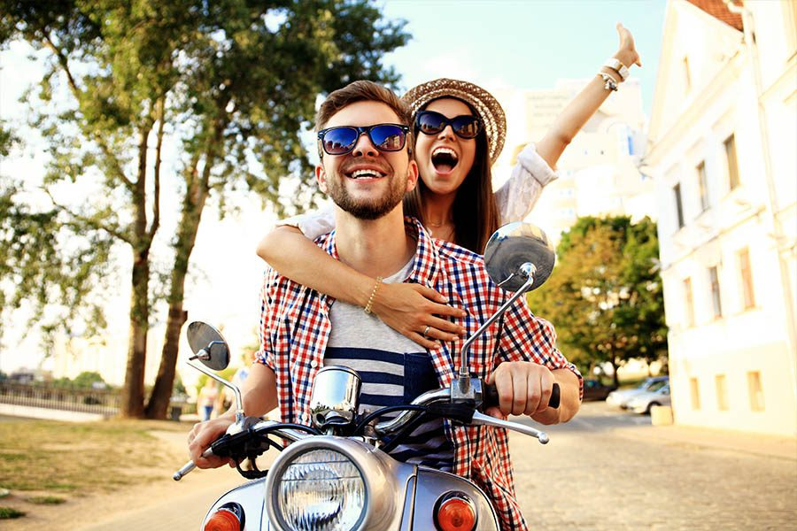Short Term Medical Insurance - Group of Friends Riding a Motorcycle During the Summer Months