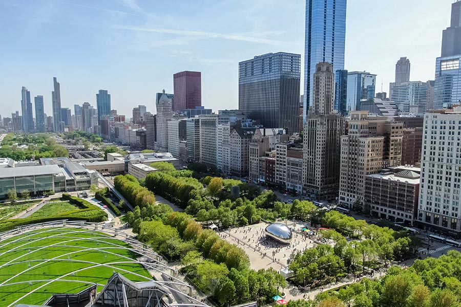 Chicago Insurance - Aerial View of Chicago Skyline, Green Parks, and the Cloud Gate Bean Sculpture on a Sunny Day