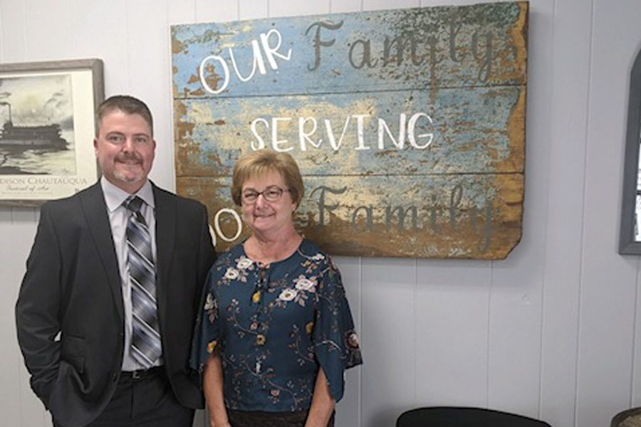 About Our Agency - Portrait of Kris and Bonnie Colen Standing Inside the Colen Insurance Office