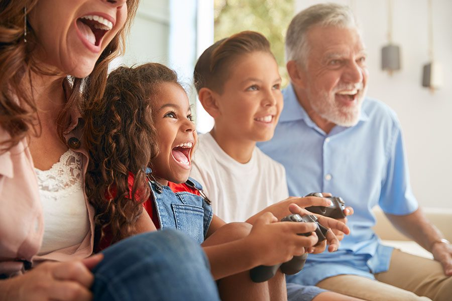 Blog - Excited Family Having Fun Playing Video Games Together in the Living Room