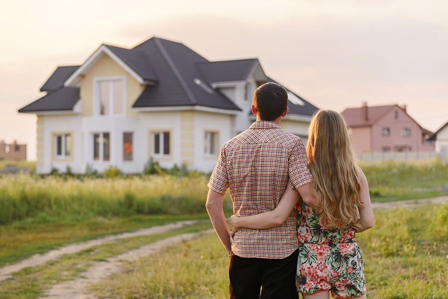 Header - Couple Looking At New Home