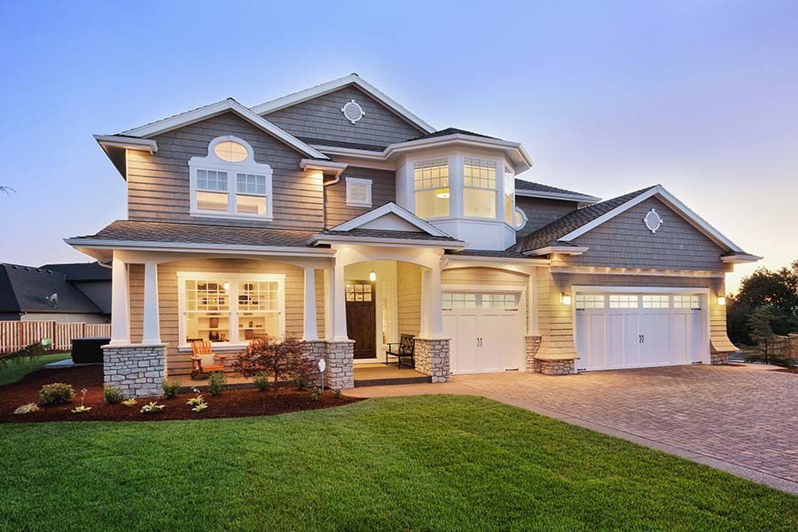 Insurance Quote - Beautiful Two Story Home Exterior In The Evening