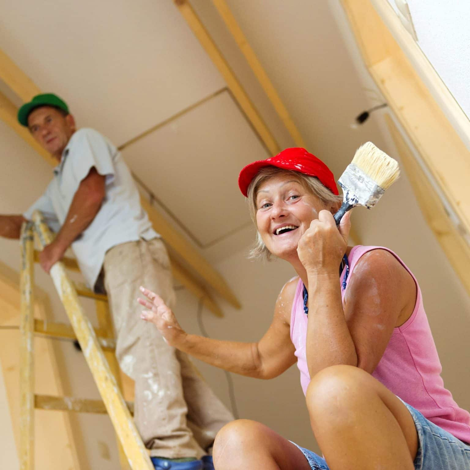 homeowners painting new house