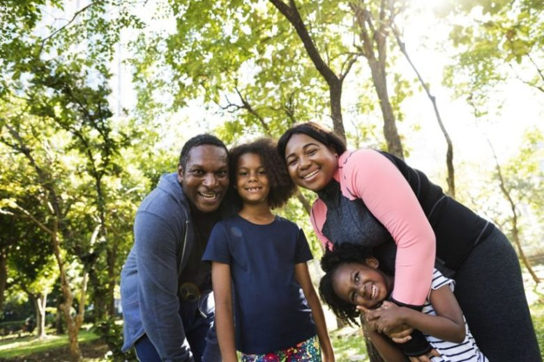 Employee Benefits - Family Outside in the Park for a Workout Together