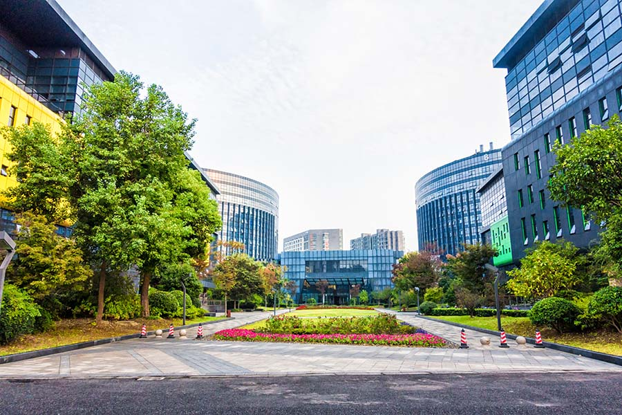 Business Insurance - View Of Modern Office Buildings Next To Park In The City
