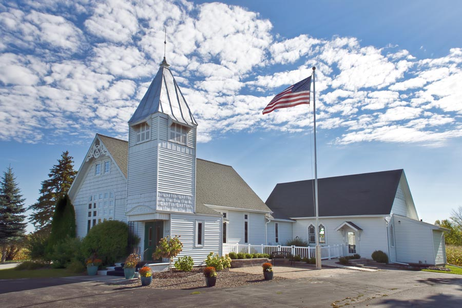 Specialized Business Insurance - Rural American Church with an American Flag Outside