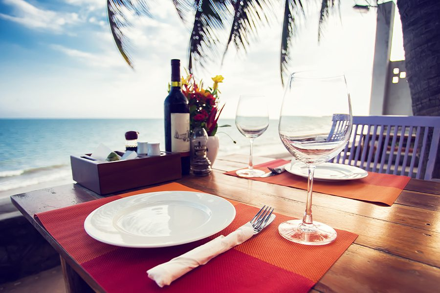 Specialized Business Insurance - Table Setting at a Small Beachfront Restaurant in the Summer at Sunset
